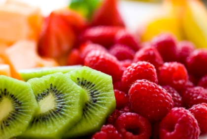 Berries Melon and Kiwi Fruit Tray.  Closeup detail of fresh healthy fruit using very selective focus and extreme shallow depth of field.  Converted from 14-bit RAW file.  ProPhoto RGB color space.